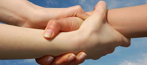 Image of three interlocking hands